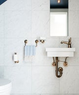 9 Fashionable Bathrooms with Bronze & Brass Fixtures
