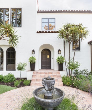 A Spanish Revival Home's Neglected Exterior Gets a Modern Makeover