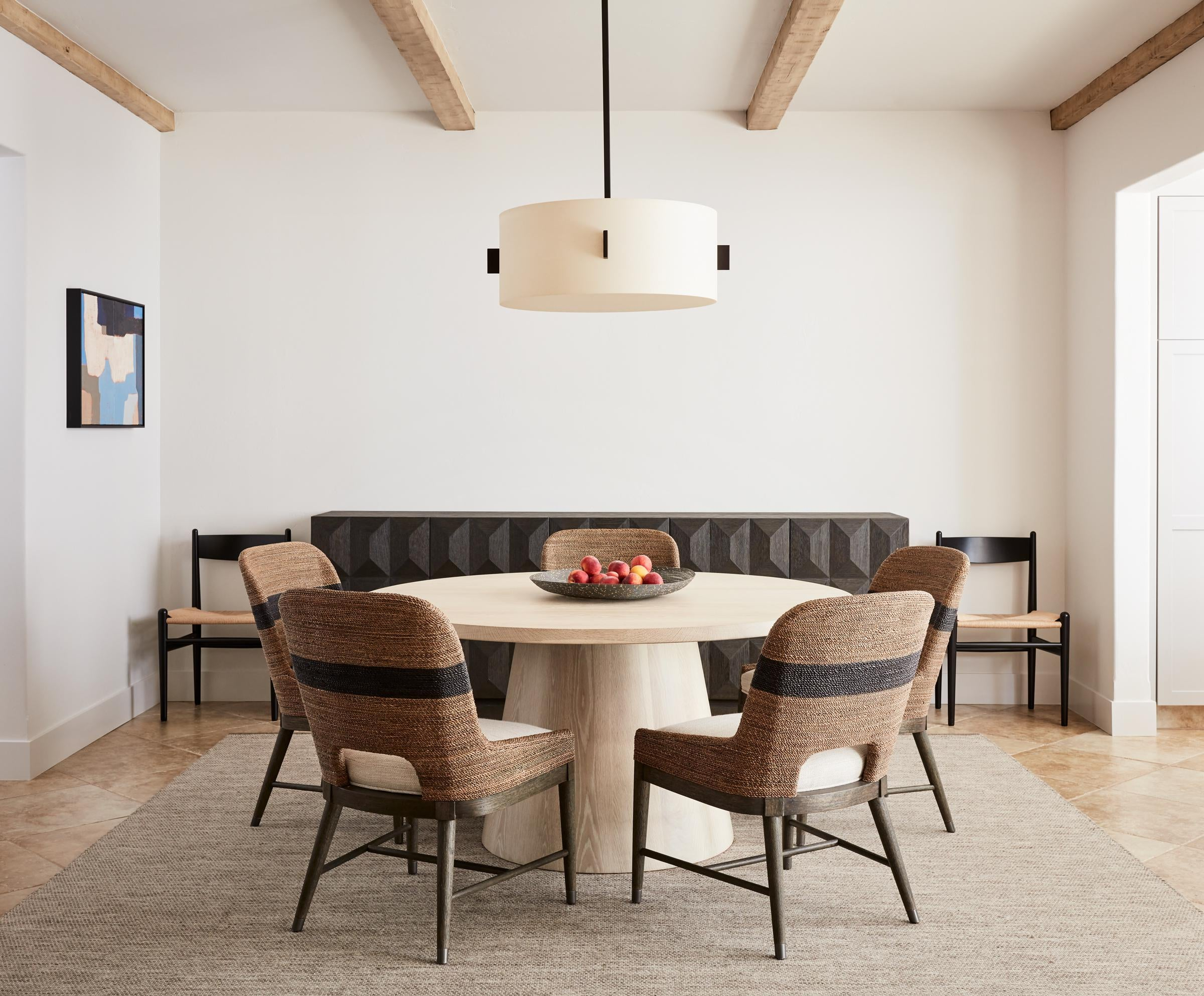 Pebble Beach Dining Room. Exposed Beams, Sideboard, And Round Dining Table.