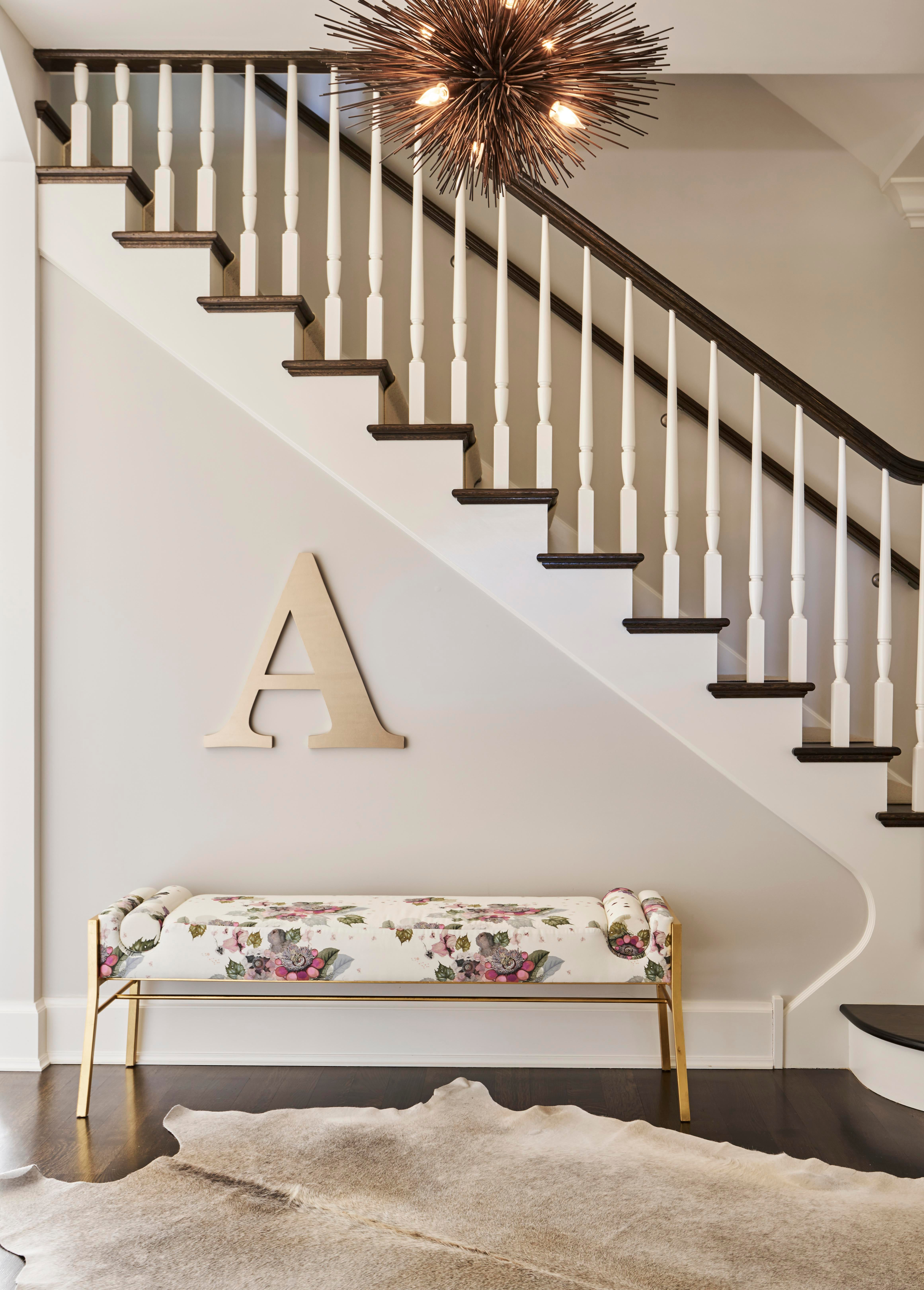 Winnetka Home, Unique Hallway Decor With Hide Rug And Statement Light  Fixture. Elizabeth Krueger Design