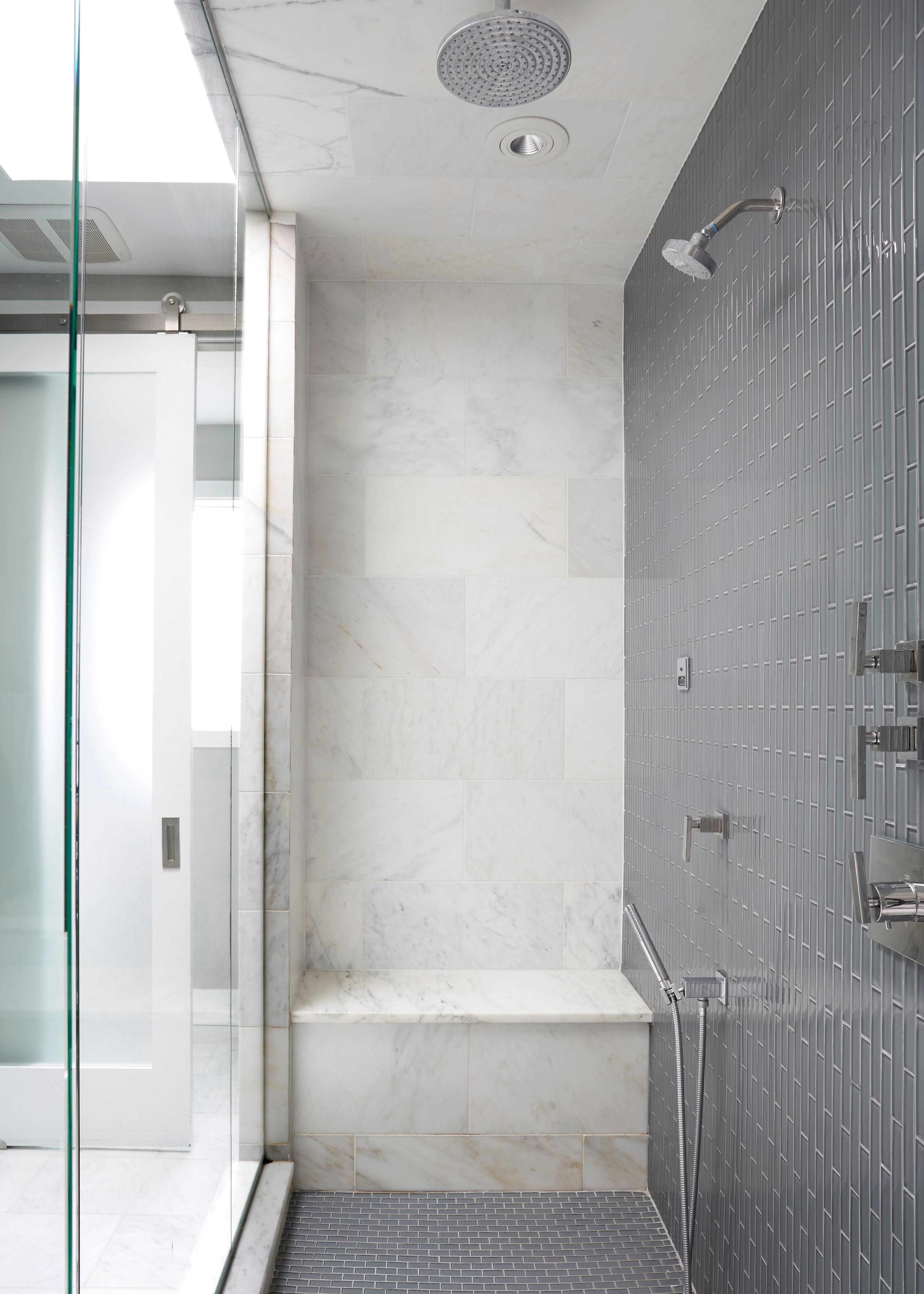 modern condo master bathroom blue vertical tile shower marble rh deringhall com