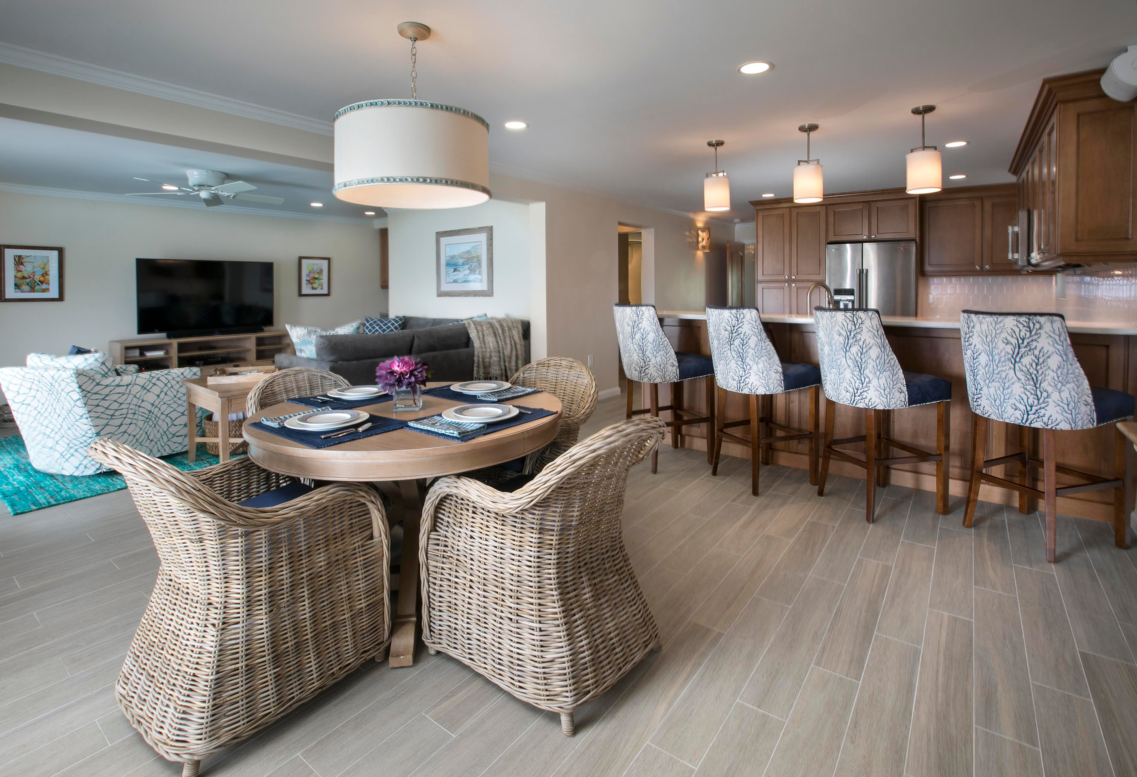 Shell Trimmed Chandelier And Grey Rattan Dining Chairs Create Casual  Elegance.