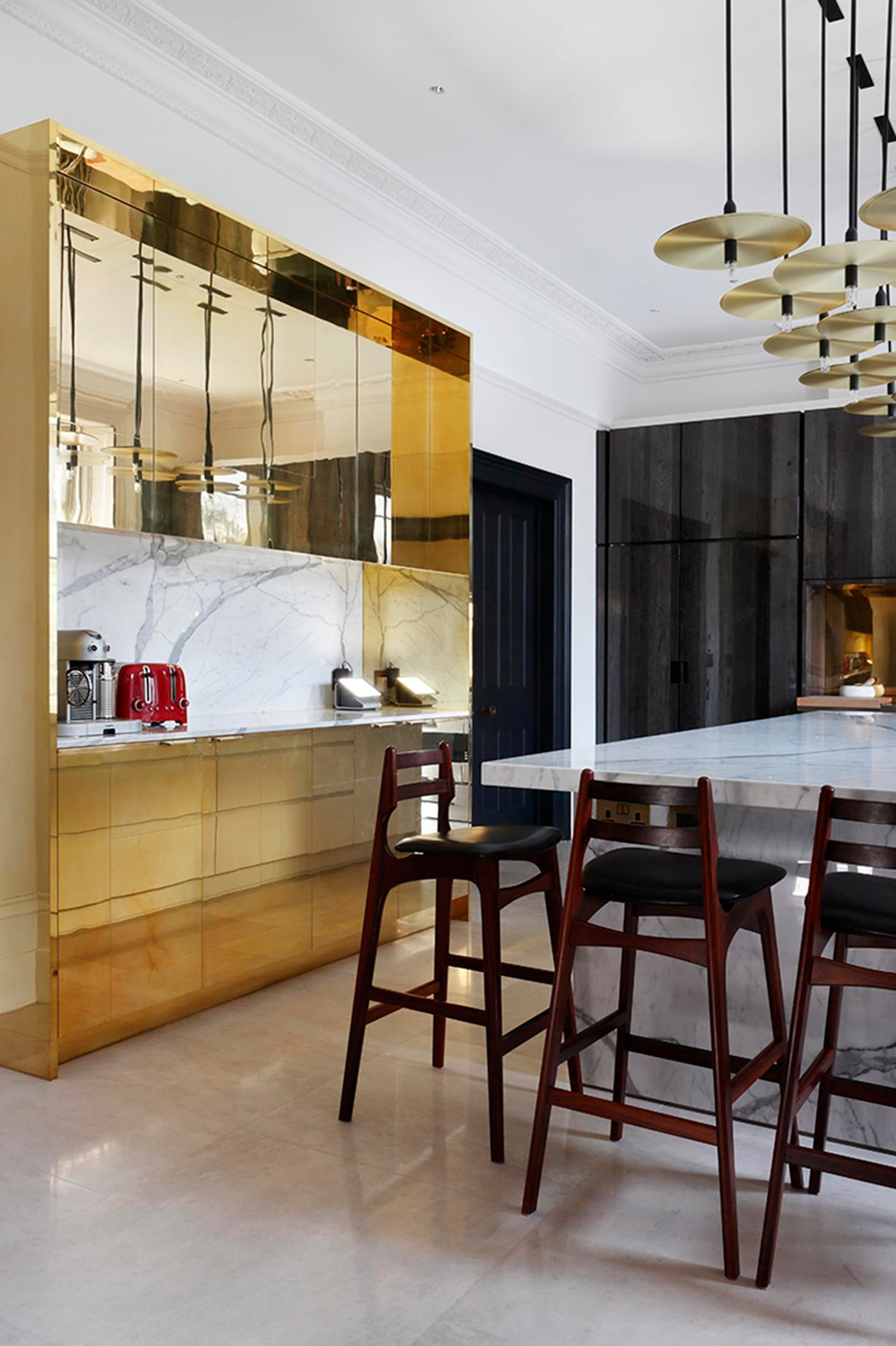 Kitchen Area Using Warm Finishes   Polished Brass Creates A Dramatic Feel.
