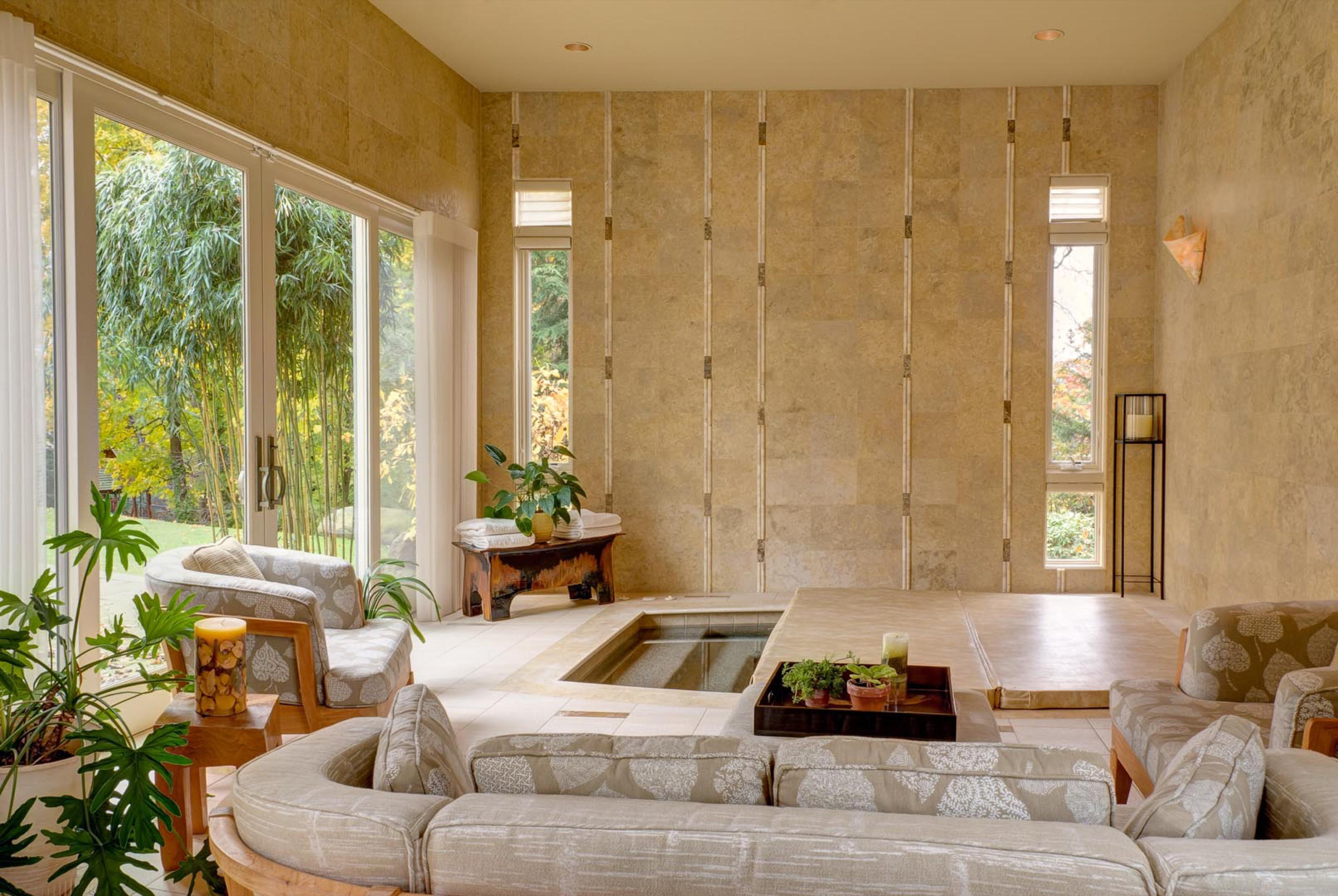Custom Designed Stone Walls With Vertical Inset Accents Of Tile And Stone