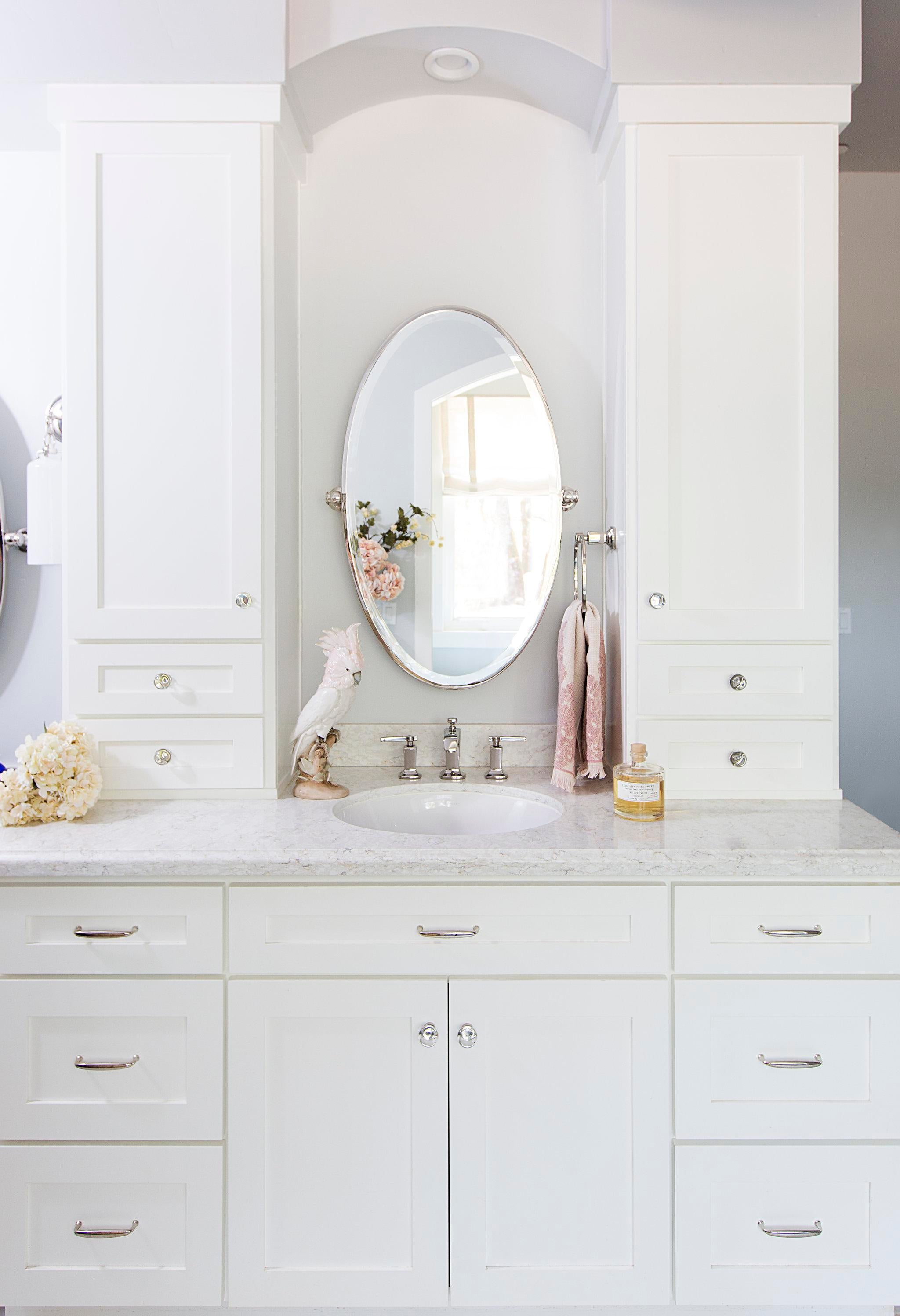 Elegant Bathroom Vanity With White Countertops And Cabinets.