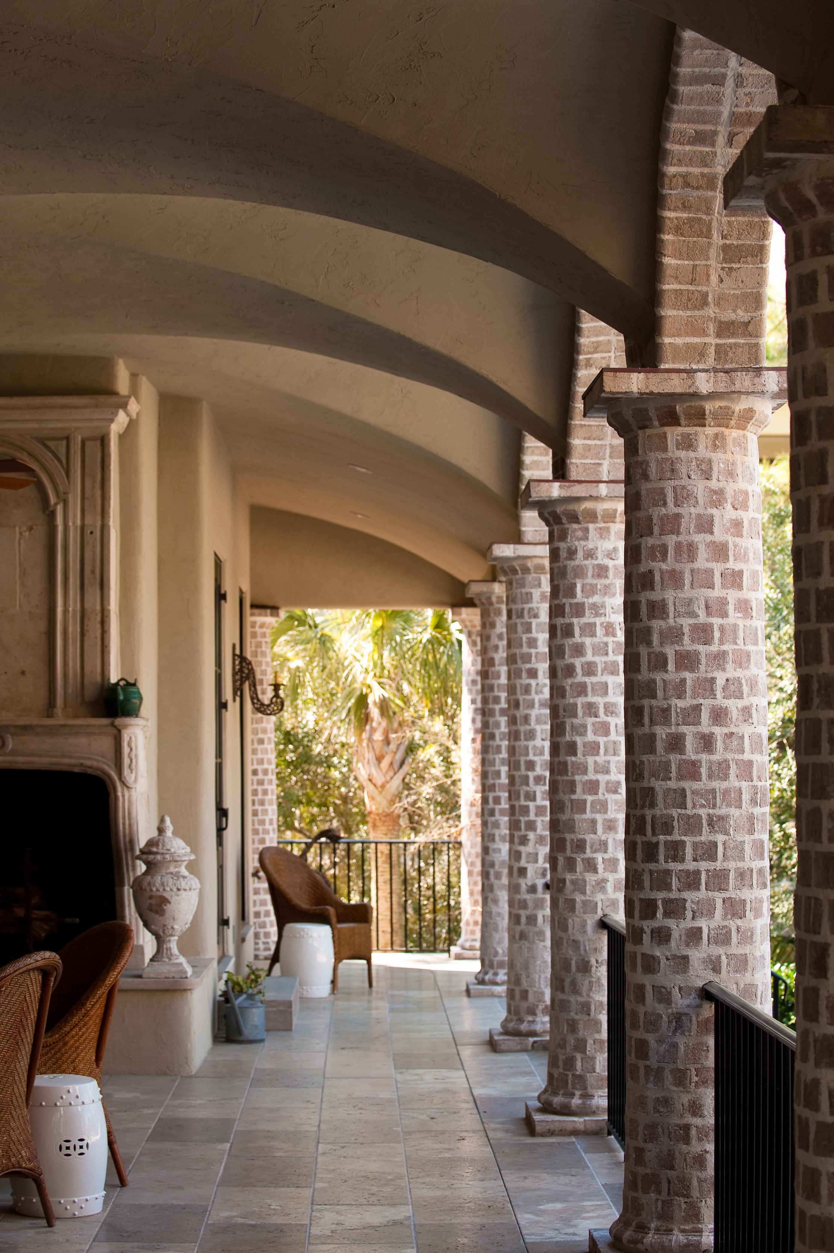 Loggia With Round Tapered Brick Columns, Plaster Groin Vaults And Stone  Mantel