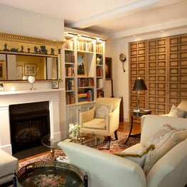 Fifth Avenue Warm and Cozy sitting room with fire place and wood wall panelling
