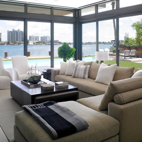 In this room a deep-seated sectional sofa is designed to be warm & inviting.