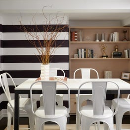 Upper East Side Breakfast Room with horizontal striped walls and metal chairs