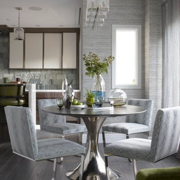 Boston waterfront penthouse dining area. Urban living at its finest.