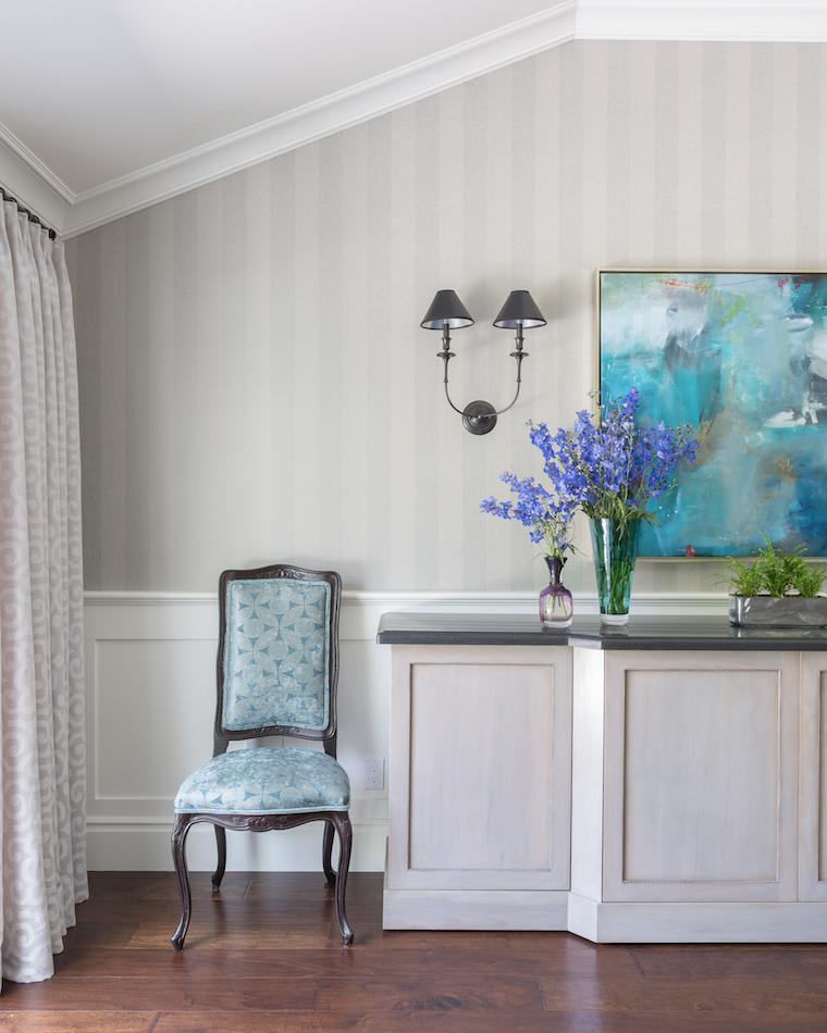 Dining room shot showing custom buffet, striped wallpaper, and custom window treatments