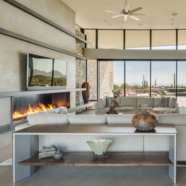 Living Room with Art Collectibles and Desert Views