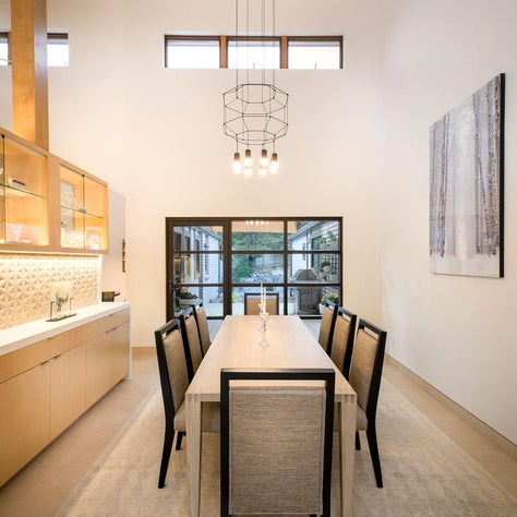 Scandi Light, dining table and chairs, bar cabinetry and dramatic pendant