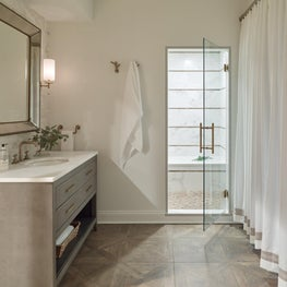 Guest Bath with Striped Shower Walls in Wood & Marble