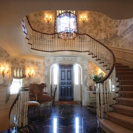 This traditional staircase is grounded in a grand entryway.