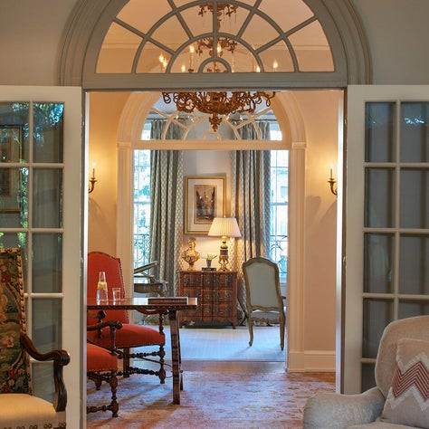 Fan-light transom over French doors flanking a stair hall in a DC rowhouse
