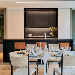 Mid-century Modern InSpace NY decors the dining with Rem Koolhaas kitchen