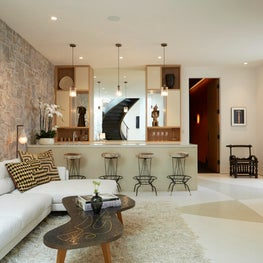 Hollywood Hills Lounge with custom terrazzo floor and stone and plaster walls.