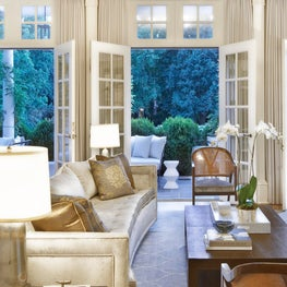 Vintage and contemporary furnishings in a Raleigh living room, with sophisticated finishes