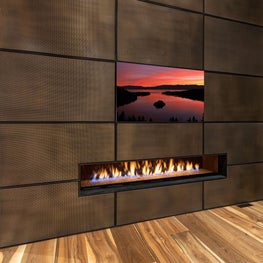 Rays of Light - ceiling-high steel fireplace surround panels with hideaway TV and walnut plank flooring