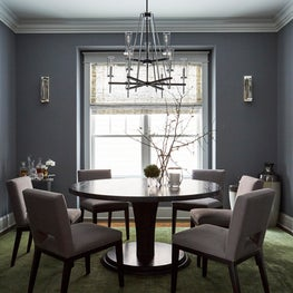Dramatic Green Dining Room with Large Artwork and Round Dining Table