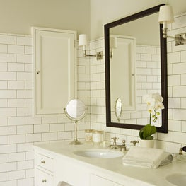 Master bathroom double vanity with subway tile backsplash and medicine cabinet