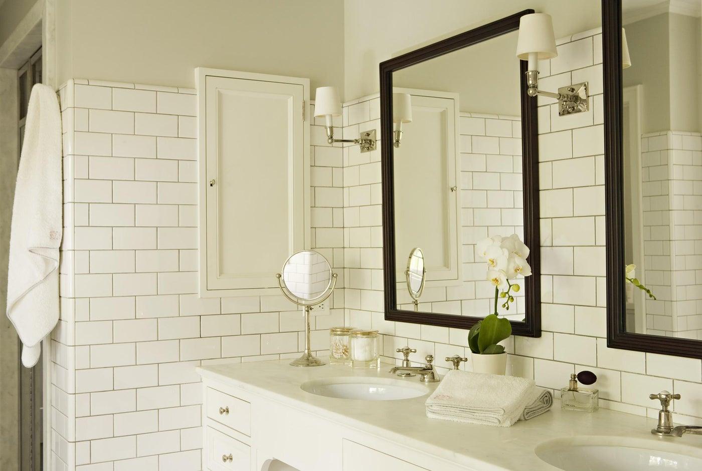 Master bathroom double vanity with subway tile backsplash and medicine cabinet