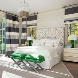 Luxe bedroom with large panel curtains