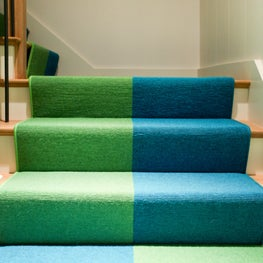 Custom Stair Runner leading to a basement