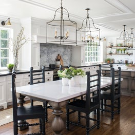 Hollywood home takes a classic turn in white subway tile, rustic woods and farmhouse touches.