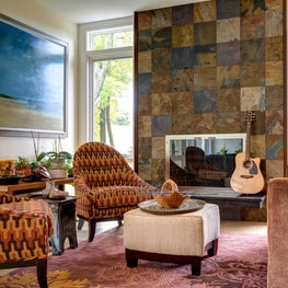 Rustic slate fireplace wall : patterned earth tone fabrics