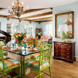 An antique chandelier hangs above a vibrant dining area.