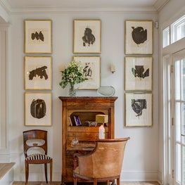 An intimate seating area with antique secretary.