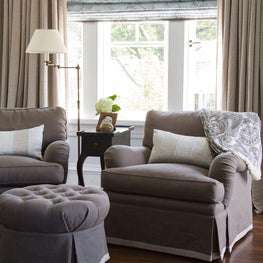 A sitting area outfitted in soothing neutral tones.