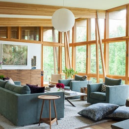 Modern mountain style great room with exposed beams