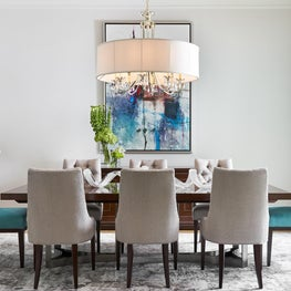 Large beach style light wood floor and beige floor enclosed dining room photo in Dallas with white walls