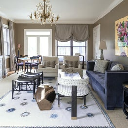 A dramatic layered rug adds panache to this elegant living room