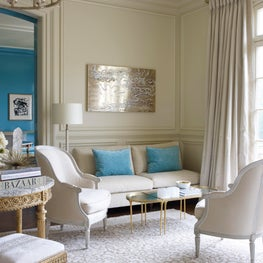 Chic neutral living room with pops of blue
