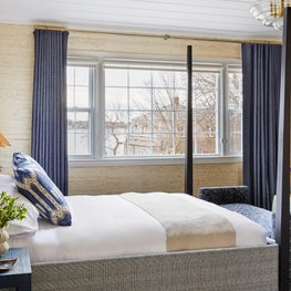 Coastal bedroom in blues and grasscloth