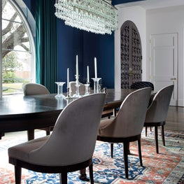 Glamorous blue dining room with wooden accents