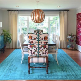 Dining room with custom chairs and framed textile art