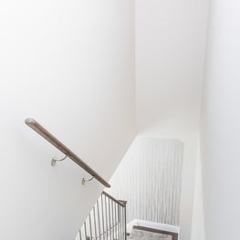 stair case design with wall paper