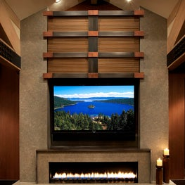 Motorized panel conceals television when needed
