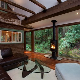 Creekside Cabin:  A new all glass addition captures and highlights the existing 1920's cabin.
