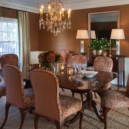 The Dining Room has English mahogany furniture and a Louis XV crystal chandelier