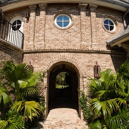 Curved Brick Connector with Arched Breezeway, Pilasters and Round Windows