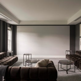 Seattle. Screening Room with custom tufted seating by Todd Merrill Studio.