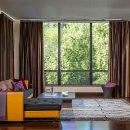 Orange Sofa with Wooden Shelving in Hillsborough Residence