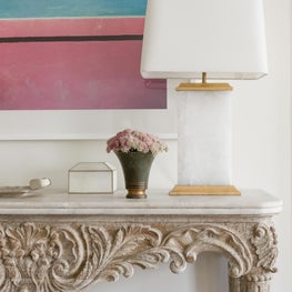 Living Room Detail of carved wood console with marble top. The lamp is quartz.