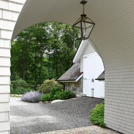 Arched Porte Cochere and stone carriage house